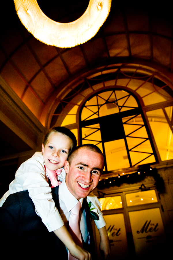 picture of bridegroom with little boy on his shoulder at Leeds winter wedding