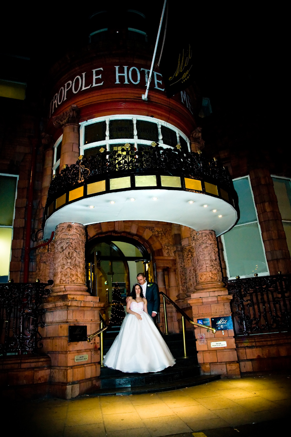 winter night time wedding picture outside hotel Metropole in Leeds