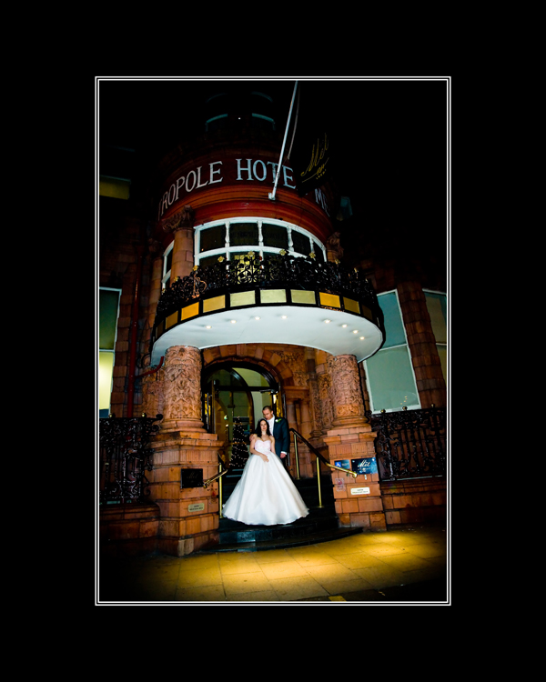 Winter wedding picture outside Hotel Metropole in Leeds at Night