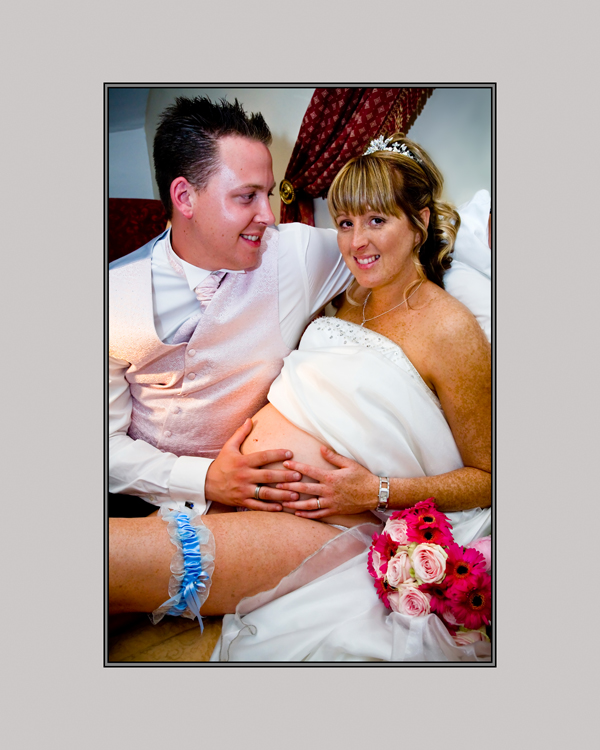 Pregnant bride shows of her bump with adoring husband