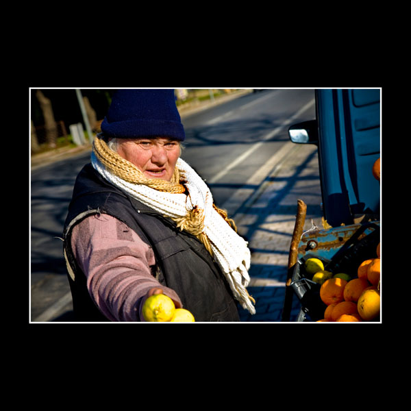 roadside seller in Arpaia Italy offering me lemons as she has had no sales all day