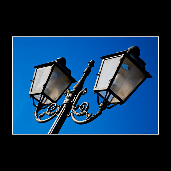 classical Italian street lamps against prefect blue foil of the January sky