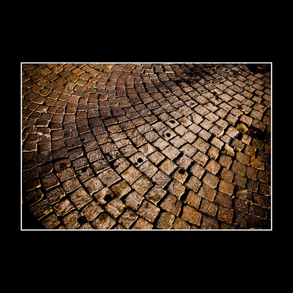 Art photo of cobbled street in Benevento, Italy
