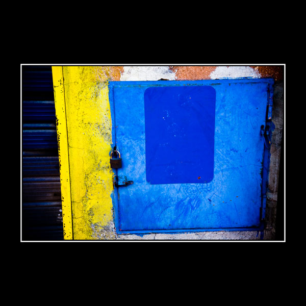 abstract art photo in Benevento Italy with lemon yellow and cerulean blue painted walls