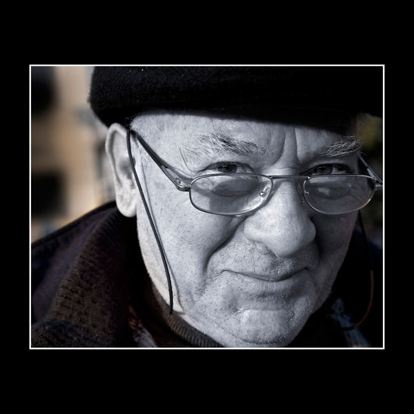 black & white portrait of intelligent Italian gentleman as he walks round old haunts in Benevento Italy