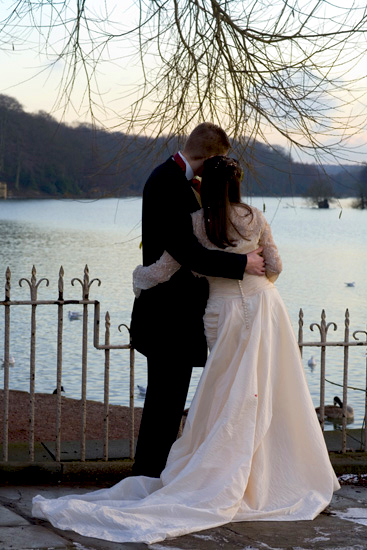 photo of bride and groom on snowy day at dusk by Newmillerdam West Yorkshire