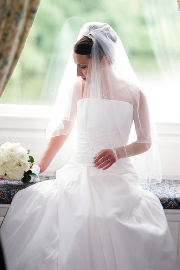 bride by window during wedding reception inside Waterton Park Hotel
