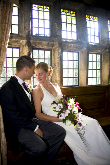 picture of bride and groom with natural light inside Holdsworth House wedding venue in Halifax