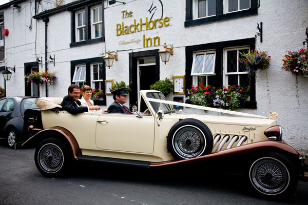 bride and groom in wedding car arriving at Black Horse in Clifton West Yorkshire
