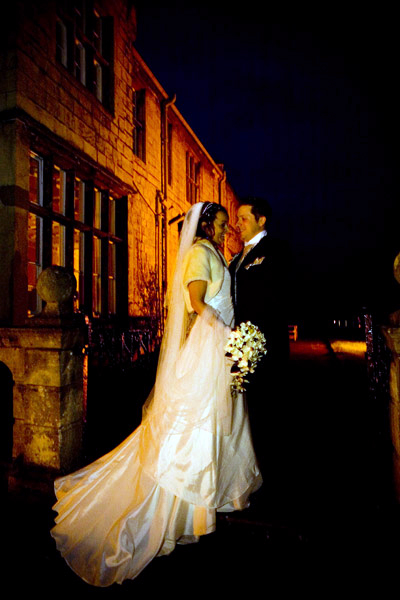 Winter wedding picture outside Monk Fryston Hall at night