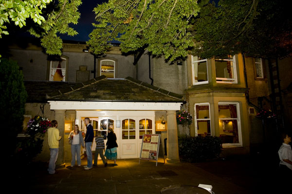 front of Steeton Hall during a wedding at night