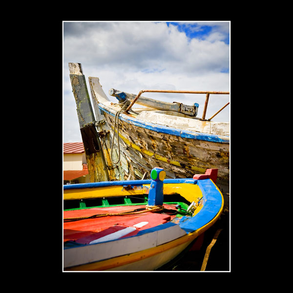 Colourful boats in Takis boatyard near the airport in Greek Island of Chios