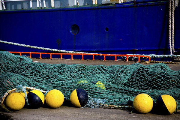 Just a simple fishing net, blue boat and yellow floats