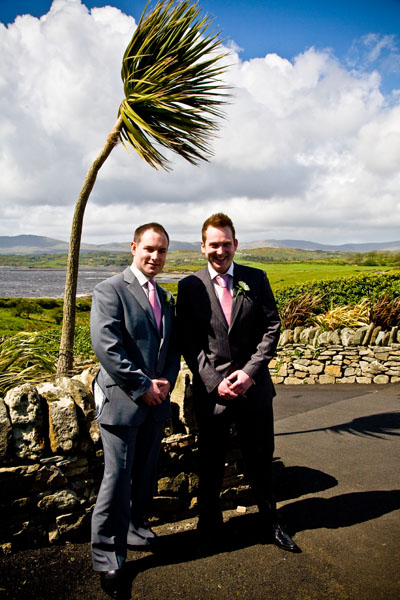 groom and best man bent by the wind outside Castle Murray House Hotel in Dunkineely St.Johns Point Donegal