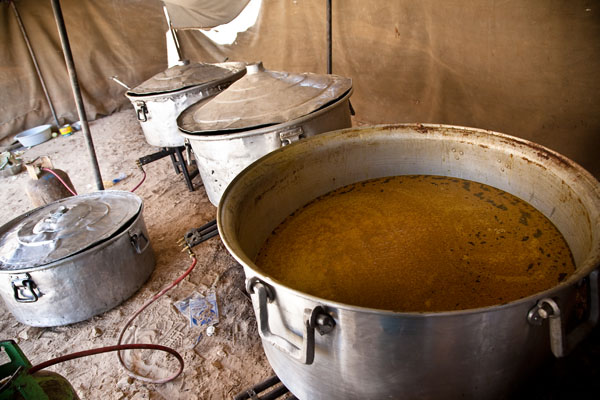 cooking pots on the boil in a separate tent at Bedouin wedding in Petra
