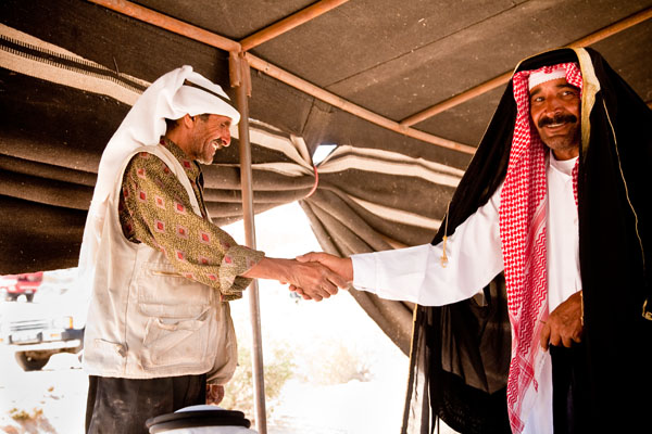 Bedouin wedding guest offers congratulations to the bride Ayesha's father