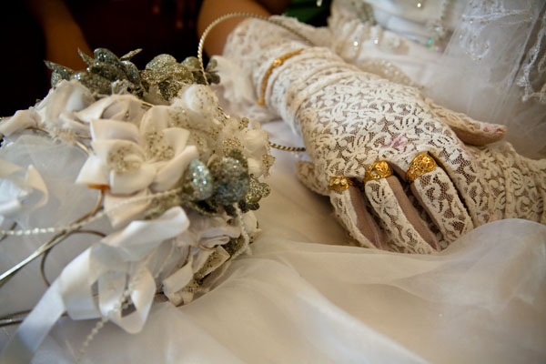 detail of Bedouin bride Ayesha's wedding outfit showing her rings on her gloved hand