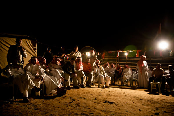night time Bedouin wedding celebrations - the men all sit together