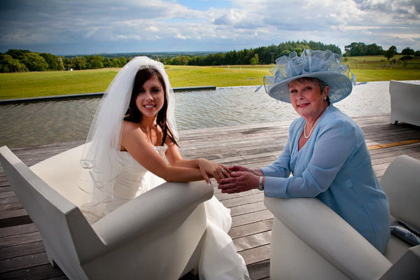 bride with her mother at KP Club Glasshouse in Pocklington with view across infinity pool
