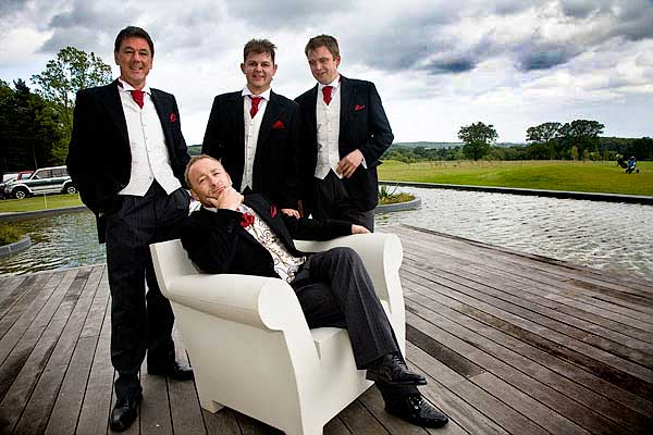 groomsmen in contemporary wedding picture by infinity pool at the KP Club Glasshouse in Pocklington