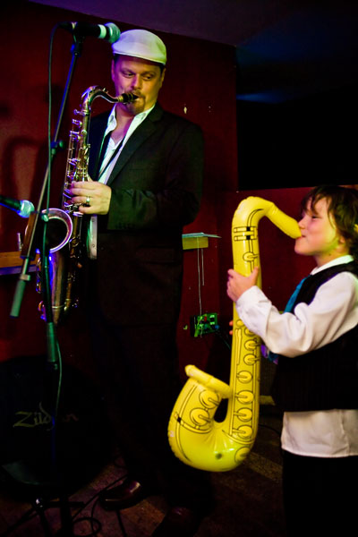 fun evening wedding reception pictures with plastic Sax and real Sax player