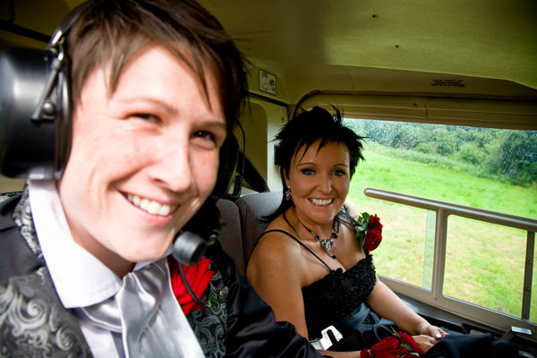 gay bride and Groom Helen & Dawn inside helicopter before surprise flight over Leeds
