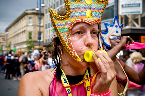 hot and weary but bravely dancing on female blowing whistle at Huddersfield Carnival 2009