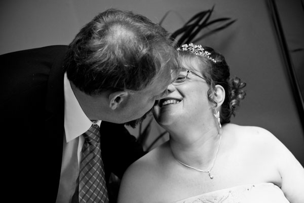 black and white photo of bride and groom kissing at St Helen's Register Office