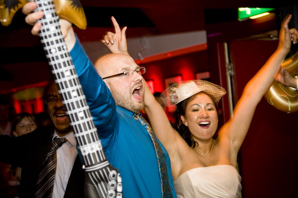 Fun wedding picture of Michelle & Keiron enjoying their evening reception.