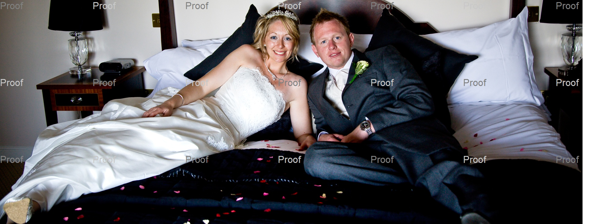 bride and groom on the bed at Waterton Park Hotel bridal suite