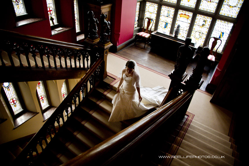 bride on grand staircase inside Carlton Towers wedding venue in Yorkshire