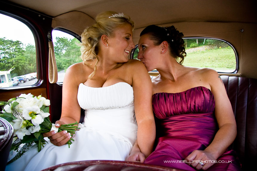 Tender girl's kiss in wedding car after Civil Partnership vows