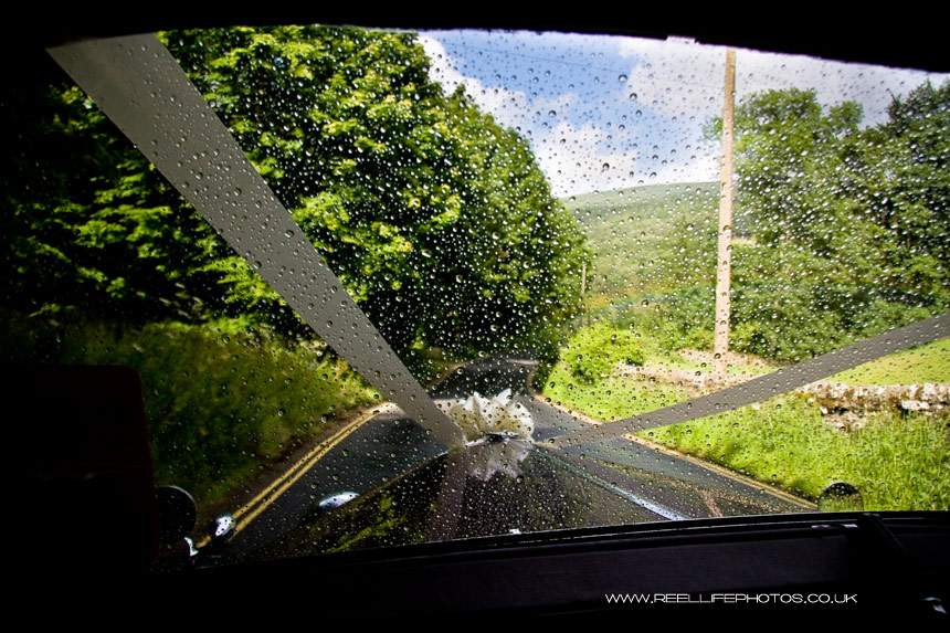 rainy day wedding picture showing the wedding car view from Windscreen