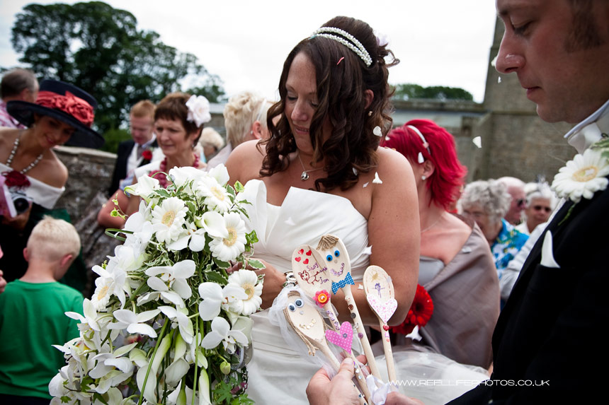 wedding gifts of decorated spoons and confetti outside Wensley Church