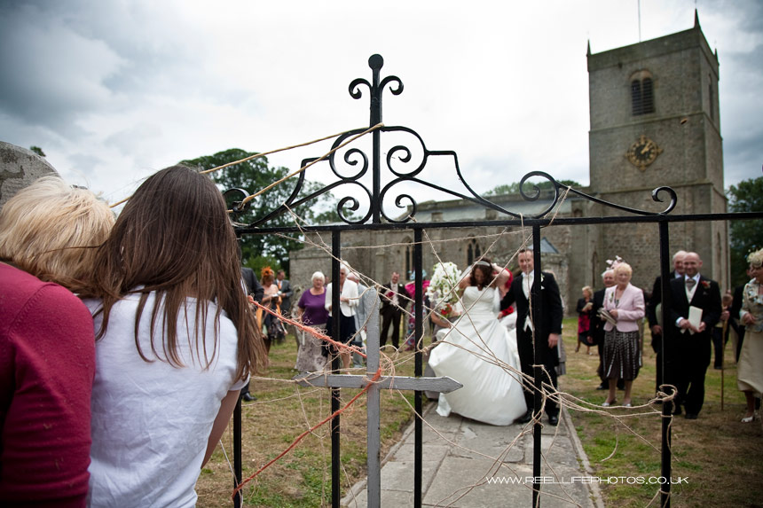 Bride and Groom about to go through Wensley churchyard gate