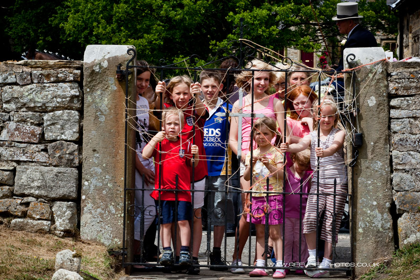 Children waiting at Wensley Church Gate for wedding tithes before they let the bride and groom out