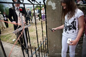 Old tradition of cutting the string on Wensley Church gate after   money has been paid by the groom