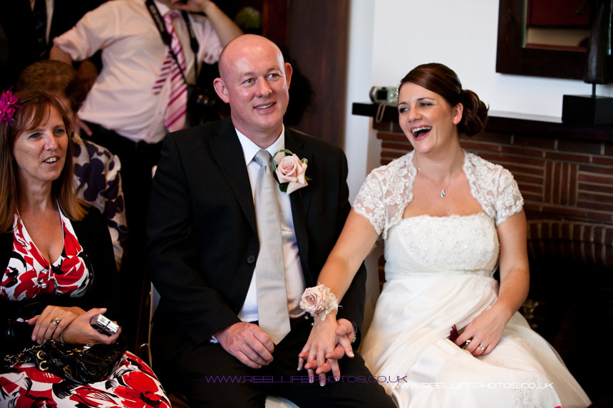 Bride and Groom enjoying the magic show at their wedding in Leeds