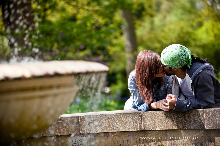 Kiss by the fountain in a park in Sheffield