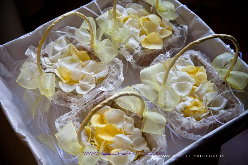 Baskets of lemon rose petals for the Flower Girls at wedding in Yorkshire