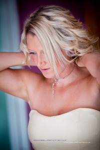Maid of Honour putting on her necklace