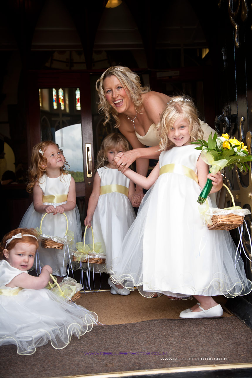 Bridesmaids and flowergirls by St Marys Church door