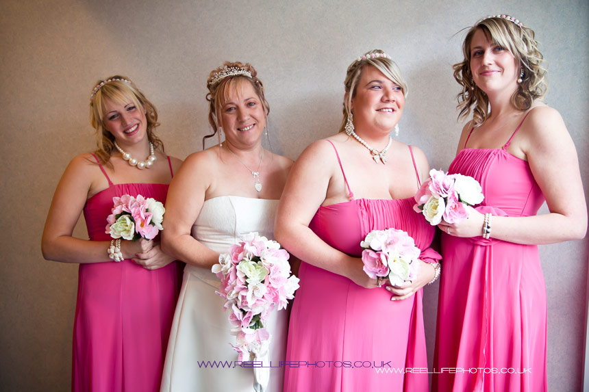 bride and bridesmaids in pink  inside Huddersfield Register Office