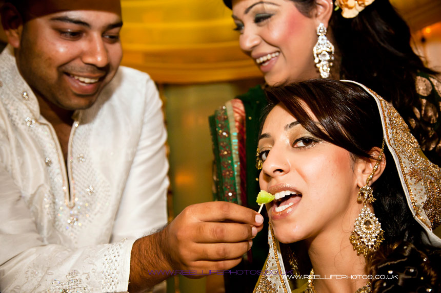 Ritualistic feed of the Asian bride at her Mehndi