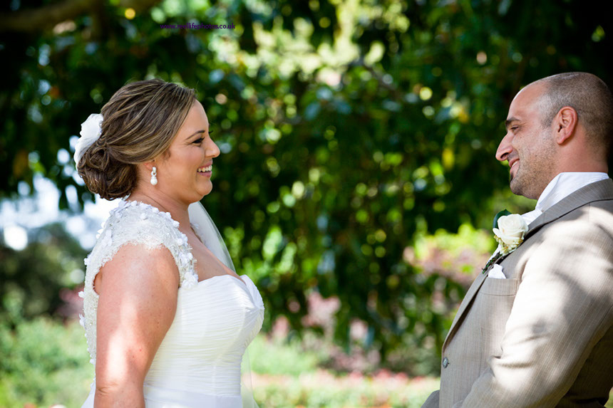 outdoor wedding in Sydney:  bride and groom saying their vows under tree