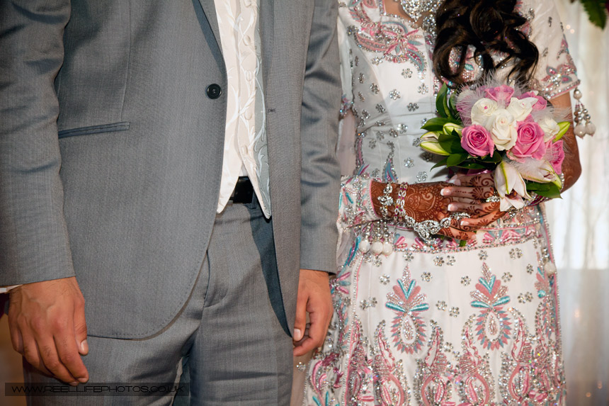 Asian wedding dress and groom's suit details