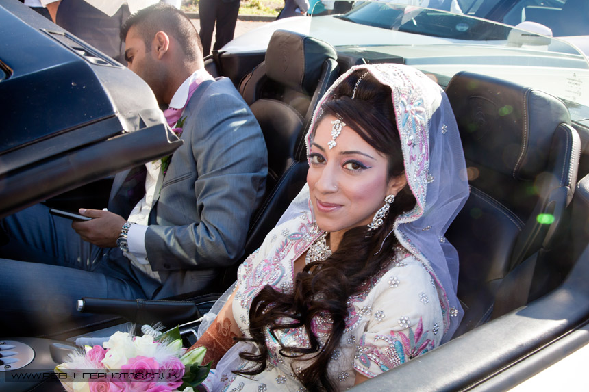 Asian bride arrives at Al Hikmah Centre in convertible sports car