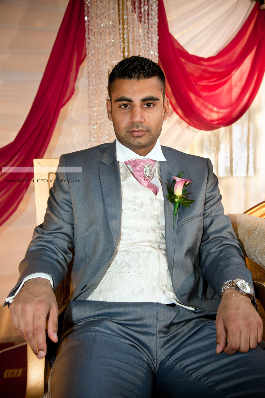 Asian Groom on the Stage seated on a throne-chair