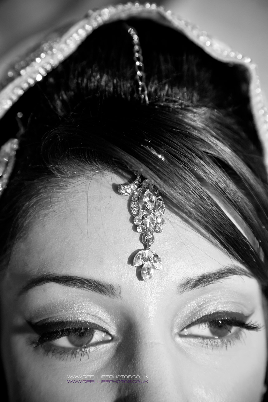 Black and White Asian wedding photo showing detail of jewellery