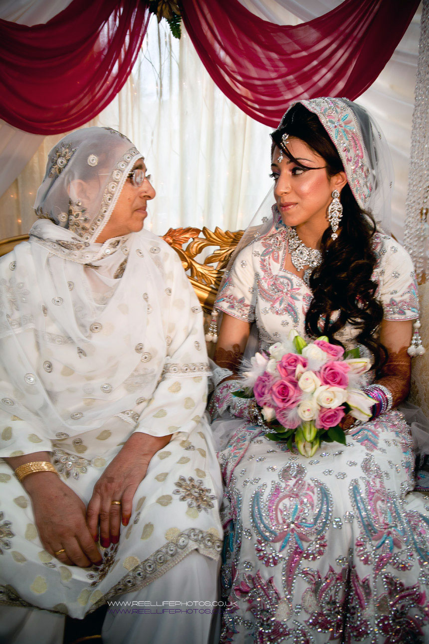 touching pic of Asian bride with her mother
